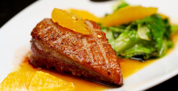 Magret de canette sauce à l'orange et ses accompagnements